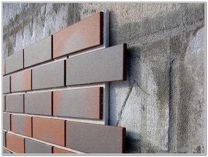 Стена из пеноблоков без утепления с отделкой декоративной плиткой.