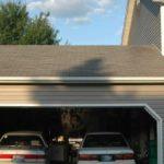 Гараж на две машины в виде пристройки к дому из пеноблока – отделка: обшивка сайдингом